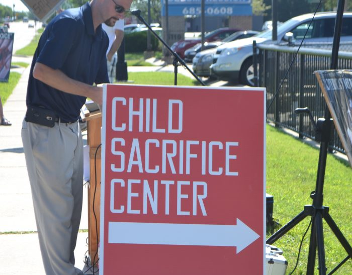 child sacrifice center sign