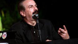 Joseph Farah speaks at a microphone
