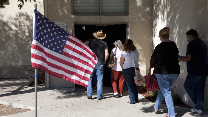 Voters waiting in line at polling place